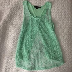 floral lace top super cute lace top from love culture.The front is completely lace and sheer. The back is a flyaway style Love Culture Tops Tank Tops