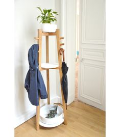This is SO much more than a coat rack. It's actually more like a plant stand, coat rack, shelf hybrid—the solution to all your small entryway storage problems.