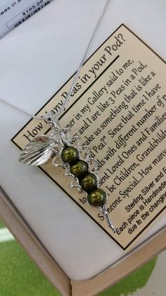 Sterling Silver and Pearl necklace, with pearls representing your children, family, or friends.