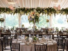 Wisteria Flowers and Gifts | English Countryside wedding reception with floral garland