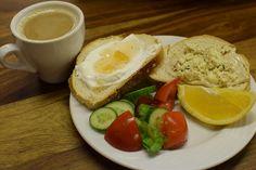 Israeli Breakfast (toast with yogurt and orange marmalade, tahini and cheese) Tel Aviv, Israel November, 2016 ESLVentures.com