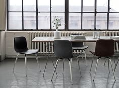 The Langue Avantgarde Dining Chair in Chrome - Leather in combination with the Chestnut Dining Table from NORR11