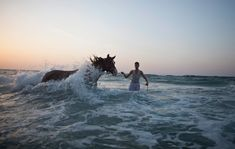 A Palestinian man washes his horse in the Mediterranean Sea in Gaza by Oliver Weiken, boston.com: Looks like a dream. #Gaza #Horse