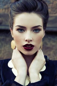 Perfect eye brows, deep red lips and matte skin