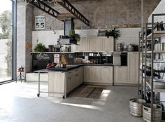 Loft-styled home with a large kitchen that complements its aura - Decoist