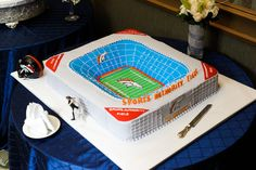 Denver Broncos Groom's Cake by Fiona's Bakery, Houston, TX (Source: http://media-cache-ak0.pinimg.com/originals/d7/f0/35/d7f03534647bb63c3eb340c3715afa02.jpg)