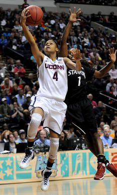UConn guard Moriah Jefferson drives past Stanford's Lili Thompson. Jefferson had 10 points and five steals.