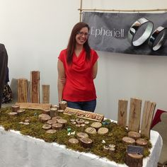 A table covered in real moss and slabs of timber, branch slices... all very beautiful! rustic display idea for jewelry