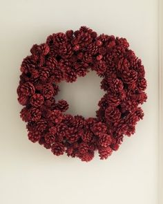 Red Pinecone Wreath.  Pinecones are finished in a high gloss, making them shine like rubies.