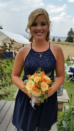 Peach Roses, alstromeria, wax flower and seeded eucalyptus maid of honor nosegay bouquet.