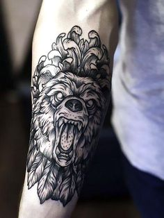 A roaring bear on the forearm tattoo idea. Shows strength and power of an owner. Style: Dotwork. Color: Black. Tags: Best