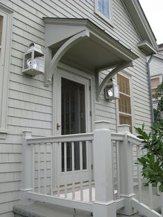 exterior-door-overhang-martha-stewarts-home-in-bedford-new-york-katonah – bedford gray – house and trim one color – best exterior paint colors Best Exterior Paint, Exterior Paint Colors, Exterior House Colors, Exterior Doors, Paint Colours, Gray Exterior, Porch Roof, Side Porch, Side Door