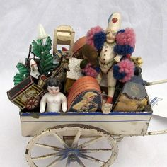 Peddler's wagon with Charlottes, Pierrots and assorted goods.