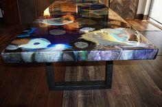About Dine Arts and the Artist: Her friends call her Sam, a very private, but exceptionally brilliant artist who resides in Southern California. Resin Art, a type of Fluid Art Design, is just one of her artistic outlets. I come from a furniture background and currently own and operate a flooring shop, specializing in custom flooring design and installation. Sam came to my shop in Carrollton, a suburb of Dallas, to collaborate on a new concept in casual dining for the home. She thought that…