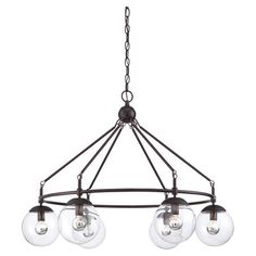 Cast a warm glow in your living room or den with this eye-catching chandelier, showcasing an English bronze finish and clear glass globes for stylish appeal....