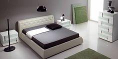 Strisce di colore verde pastello danno un tono fresco e giovane ad una delle nostre più belle camere da letto.