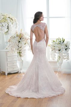 DETAIL DESCRIPTION The portrait neckline of this dress gives off a timeless elegance that will make you shine on your wedding day. Intricately embroidered lace over double-faced organza and a fit and flare skirt make for a classic and elegant bridal gown.