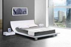 The uniquely shaped bed frame makes the Story White Platform Bed with 2 Nightstands a fine addition any contemporary sleeping quarter. A curved headboard paired with the sophistication of glossy white finish gives any space a relaxed,contemporary atmosphere. This bed's low to the ground design sets it apart from its contemporaries.