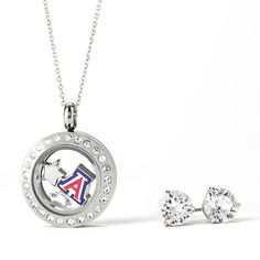 """Put your """"Grad's School Here"""" in a Living Locket that captures her school pride! Featuring Classic Crystal Stud Earrings with Swarovski Crystals, and a collegiate Charm you can swap for the school of your choice, this Origami Owl Living Locket look is ready for further customization! Add the Charms to further tell her college story."""