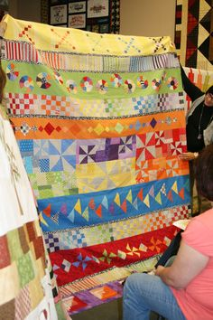 Row Quilts in a Round Robin - very cool