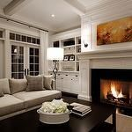 living rooms - gray sofa taupe pillows French doors transom windows white built-ins cabinets shelves fireplace orange red abstract art black sconces black Arteriors floor lamp espresso rectangular coffee table sisal | http://homedesigncollections.blogspot.com