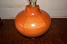 A smaller segmented vessel with a natural finish