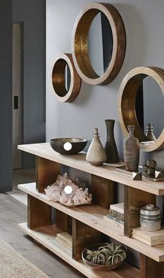Round mirrors are held by thick wooden frames that evoke the glamour of a luxury liner. Shiny brass trim on the inner rim accentuates the clean and simple design. Made of mango wood with a waxed finish. x deep Medium dia. Living Room Mirrors, Living Room Furniture, Living Room Decor, Wooden Furniture, Furniture Ideas, Trendy Furniture, Simple Furniture, Outdoor Furniture, Bathroom Furniture
