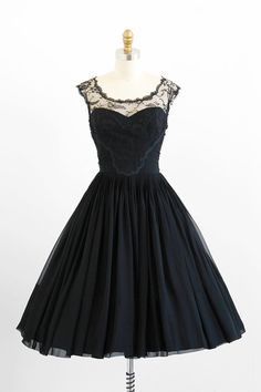 vintage 1950s black silk chiffon + chantilly lace illusion bridesmaid dress by Karen Stark for Harvey Berin. #dress #romantic #feminine #fashion #vintage #designer #classic #dramatic #partydress #frock #highendvintage
