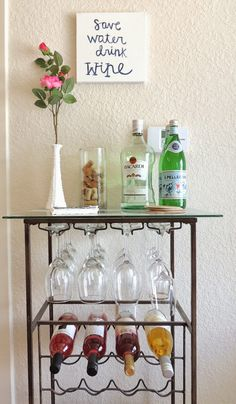 In love with my DIY bar cart! Never forget to add sparking water and flowers to make it POP!