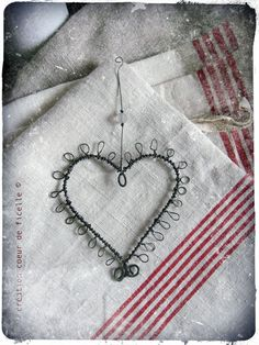 wire heart and vintage red stripes.  vintage spool and needle. Repinned by www.silver-and-grey.com