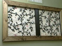 wrought iron wall decor | snijders frames a leaf and vine shaped wrought iron piece with pine ...