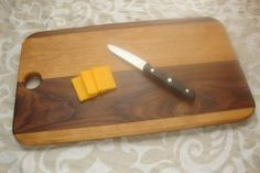 Cherry and Black Walnut cutting board, 18 inches in length on Etsy, $50.00