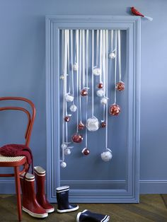 hanging ornaments in a frame? Such a sweet idea.