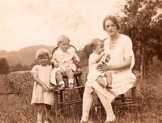 Mamaw Pingleton holding uncle Herman, Sherman in the chair and the little girl is Margret.