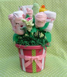 New Baby Flower Bouquet. Cute idea along with diaper cakes for a shower