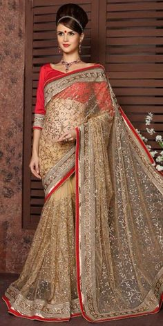 Heartily Beige Net Saree With Blouse.