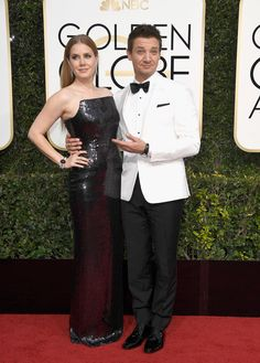 Actors Amy Adams (L) and Jeremy Renner attend the 74th Annual Golden Globe Awards at The Beverly Hilton Hotel on January 8, 2017 in Beverly Hills, California.