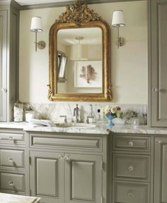 Maison Luxe - Sophisticated master bathroom with gray walls, bathroom cabinets painted Benjamin Moore Rockport Gray, marble countertop, Barbara Barry Small Simple Scallop Pendant, Thomas O'Brien Bryant Sconces flanking gilt mirror.