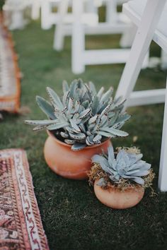 Pull off an effortless boho, festival-inspired wedding with these adorable potted succulents framing an aisle lined with carpets.