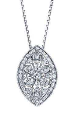 The exquisite milgrain channel setting and open, lacy design of this pendant is perfectly suited for a lace wedding gown.