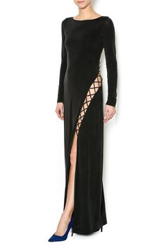 Soft stretch long sleeve black dress with a back cage cut out design and a high side slit. This dress is fully lined.   Lace Up Dress by The JetSet Diaries. Clothing - Dresses - Maxi Clothing - Dresses - Long Sleeve New Orleans, Louisiana