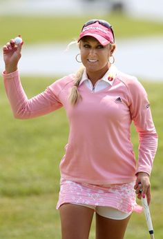 SPRINGFIELD, IL - JUNE 10:  Natalie Gulbis acknowledges the crowd on the ninth hole green during the second round of the LPGA State Farm Classic at Panther Creek Country Club on June 10, 2011 in Springfield, Illinois.  (Photo by Christian Petersen/Getty I