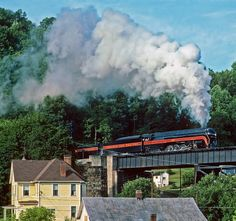 Beautiful J class 4-8-4 number 611 crosses a bridge at Bramwell, WV in June of 86 on an excursion trip. The last engine of its kind, it resides at the Virginia Railroad museum. The reserve tender in the picture was not part of the original train. Was constructed later because of a lack of watering facilities due to the switch over to diesel power.