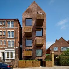 Slender+apartment+block+by+Amin+Taha+Architects+features+a+timber+structure+and+wicker+balconies