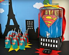 Superhero Birthday Party Ideas - I love the Superman punch dispenser & the little bottles with the capes. Superman Birthday Party, Superhero Theme Party, 5th Birthday Party Ideas, 10th Birthday Parties, Boy Birthday, Superman Party Decorations, Anniversaire Captain America, Wonder Woman Party, Festa Party
