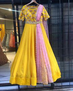 Beautiful sun shine yellow color floor length anarkali dress with blush pink color dupatta. Anarkali dress with hand embroidery work on yoke. Meenakshi collection of Mrinalini Rao. 06 January 2018