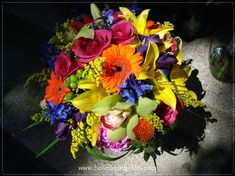 #BellesBride Molly.  Summer flowers in hot colors, Roses, Lilies, Gerbera Daisies, Cymbidium Orchids, Iris, Delphinium and more...  St Julie Church, Tinley Park, DiNolfo's Banquets, Mokena.  Belles and Thistles Floral Design.  July 12, 2013