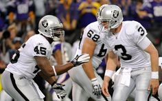 Carson Palmer #3 of the Oakland Raiders calls a play on the line of scrimmage to Marcel Reece #45 in the fourth quarter against the Minnesota Vikings on November 20, 2011 at Hubert H. Humphrey Metrodome in Minneapolis, Minnesota. The Raiders defeated the Vikings 27-21.