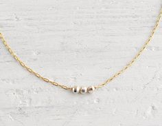 Icing  tiny gold & sterling silver beads necklace  by edor on Etsy, $24.00