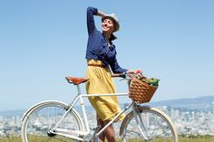 This is pretty.  I wish I could be her.  The bike, the dress, the basket...sigh